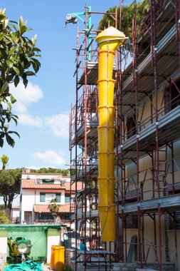 Plastic tube for debris dumping mounted on a scaffold