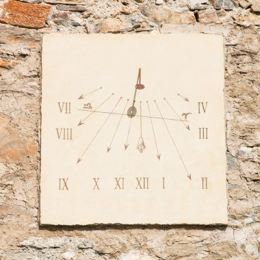 vertical sundial made of  carved stone's slab  and  iron rod