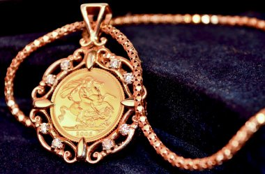Gold sovereign coin as woman's jewelry pendant on a chain