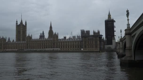 Houses Of Parliament Viewed Across River Thames On Downcast Day. Locked Off