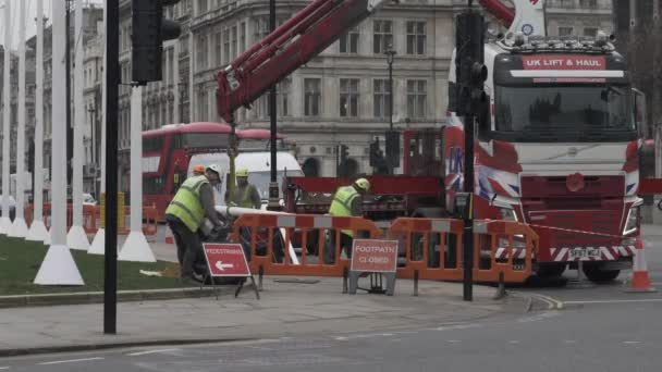 Workers Clearing Up Rubbish Beside Knuckle Boom Crane Lorry At Parliament Square. Locked Off