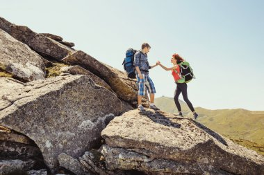 Young couple climbing in the mountains