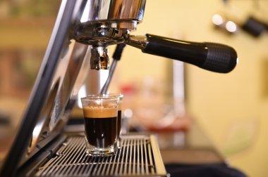 Coffee machine preparing cup of coffee