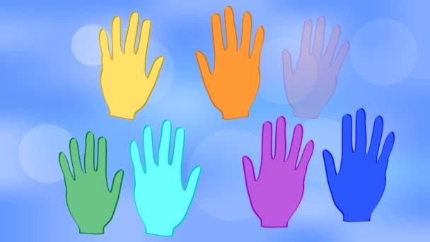 Mává rukama v barvách duhy na pozadí modré bokeh. Bílé srdce na dlaních. Animace s tématem mír