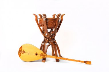 Kazakh national instrument dombra and taikazan on white background