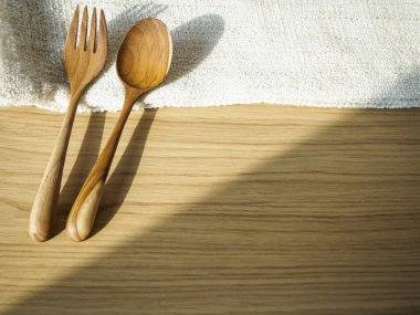 Fork and Spoon on wooden table home decoration