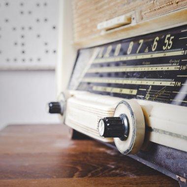 Retro Radio on wooden table close up tuner