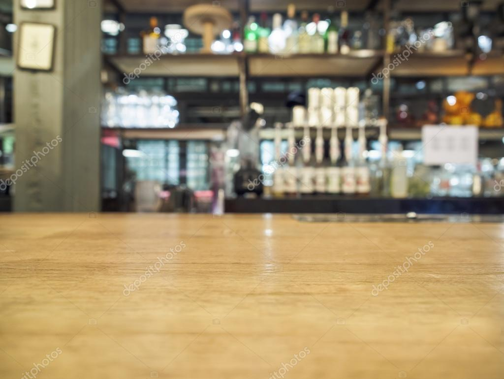 Top of wooden table with blurred bar kitchen background for Kichan image