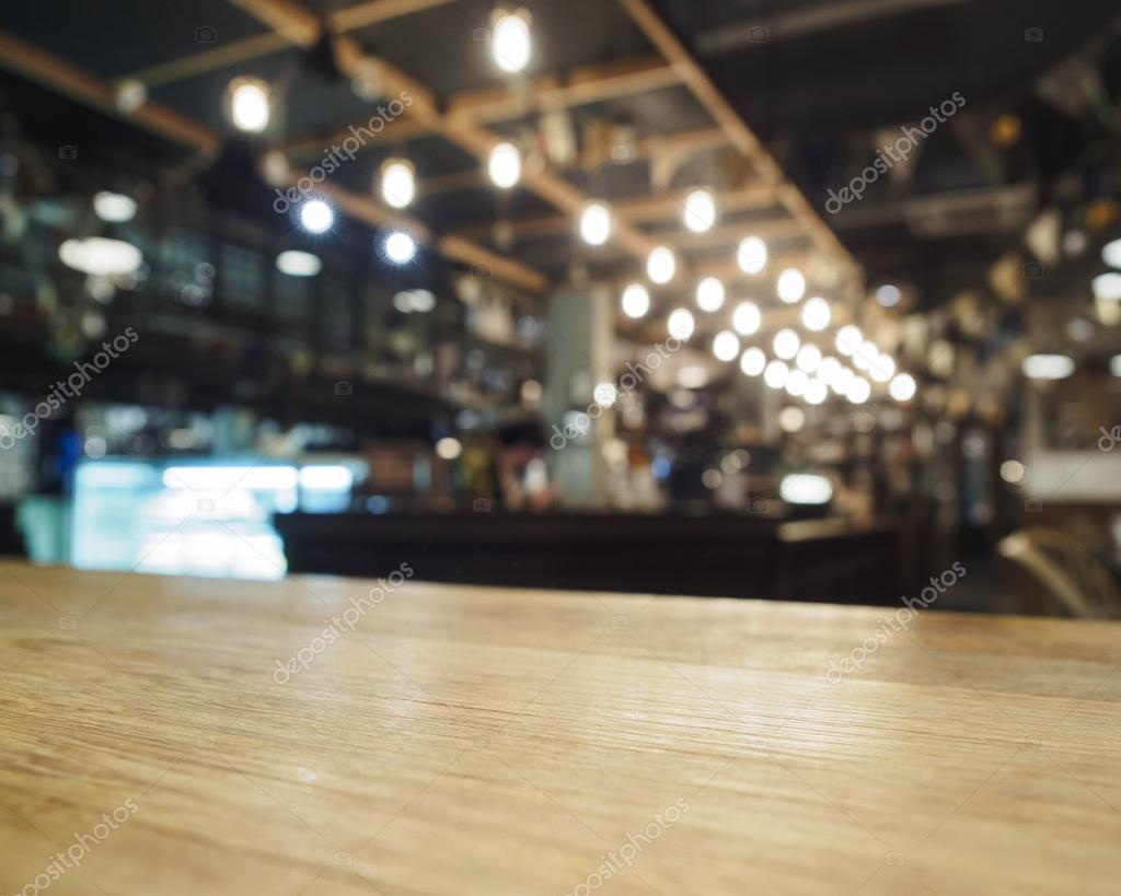 top of wooden table with bar blurred restaurant cafe. Black Bedroom Furniture Sets. Home Design Ideas
