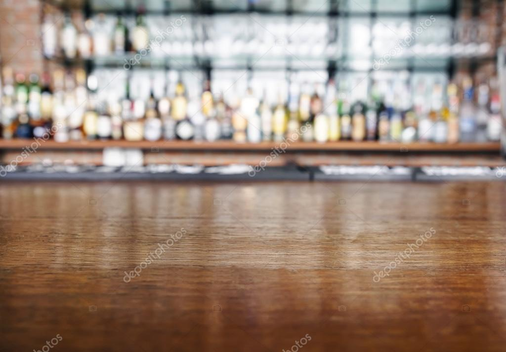 Top wooden table with restaurant Bar Blurred Background