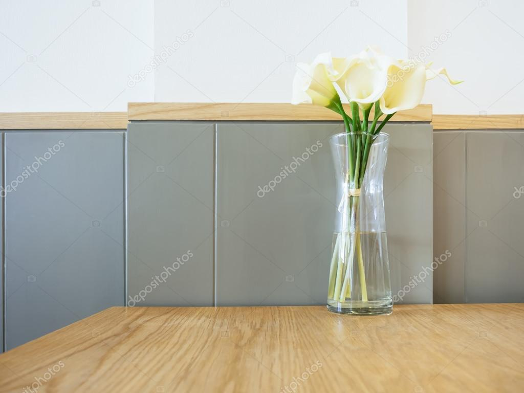 White calla lily flowers in glass vase on table home decoration white calla lily flowers in glass vase on table home decoration stock photo reviewsmspy