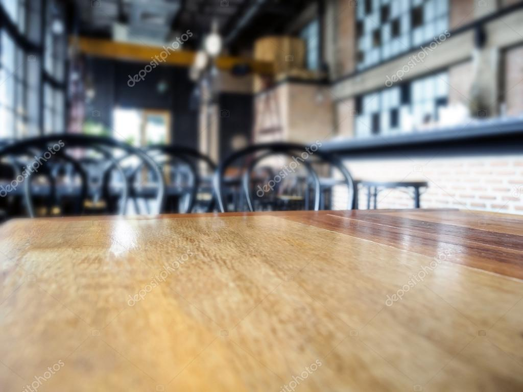 tabel top teller en stoelen met blurred bar restaurant interieur achtergrond foto van viteethumb