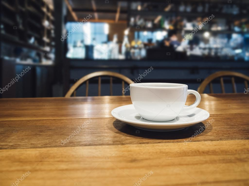 Coffee cup on table bar restaurant cafe background stock photo coffee cup on table bar restaurant cafe background stock photo 86701600 geotapseo Gallery