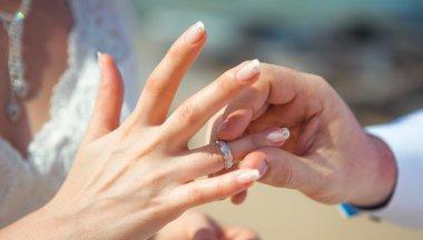 A man wears a ring woman wedding