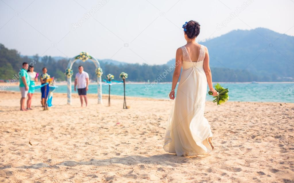 Wedding ceremony in the European style with an arch on the ocean