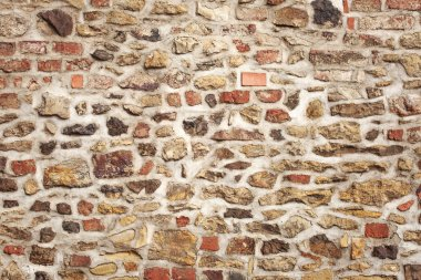 Old stone and brick medieval wall
