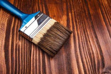 paintbrush on wooden surface