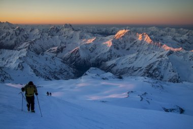 Alpinists on their way to the Elbrus in daybreak time.