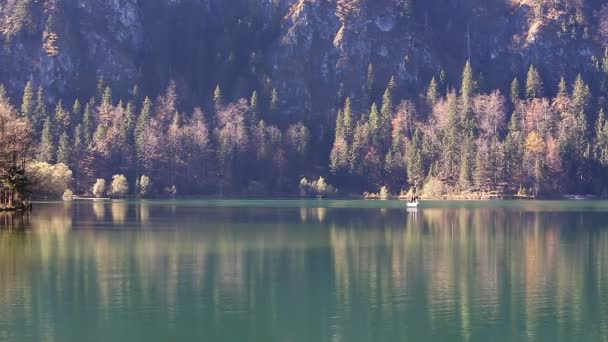 Fishing on the lake in the Alps