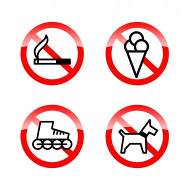 set of prohibition signs at the entrance to the store or shop