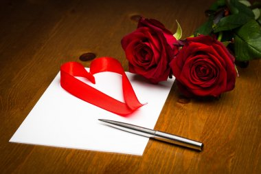 Ribbon Love Heart On Paper With Pen And Roses