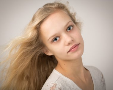 Portrait Of A Blue Eyed Blond Teenage Girl
