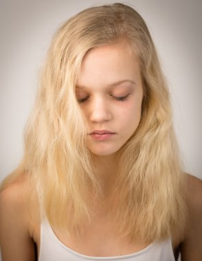Beautiful Serious Blond Girl With Closed Eyes