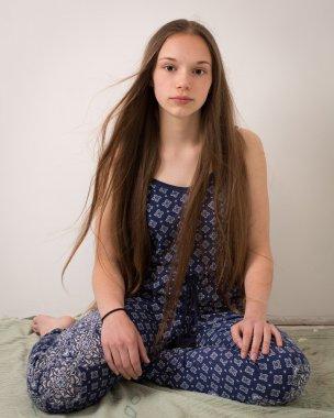 Beautiful Brunette Teenage Girl In Blue Pajamas