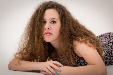 Beautiful Curly Ginger Girl Teenage Girl On The Floor