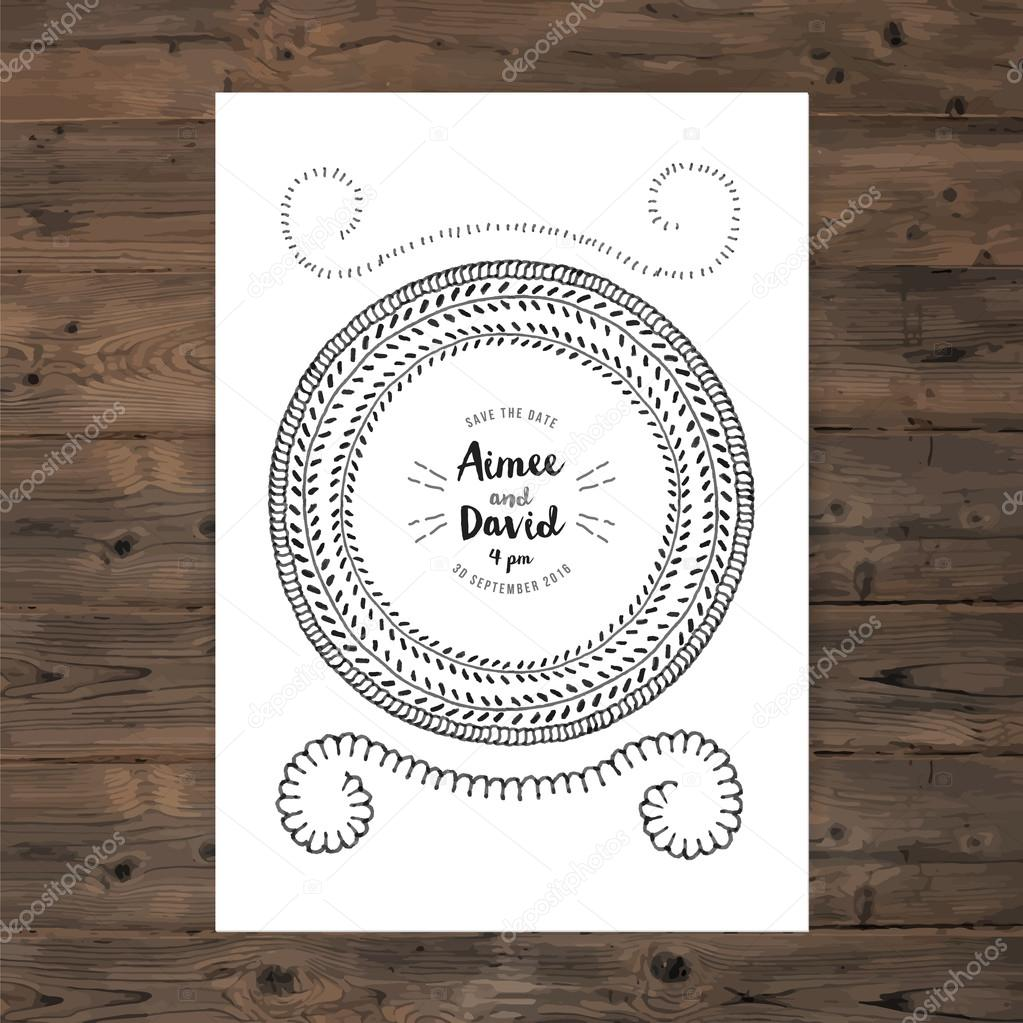 wedding invitation card with floral wreath