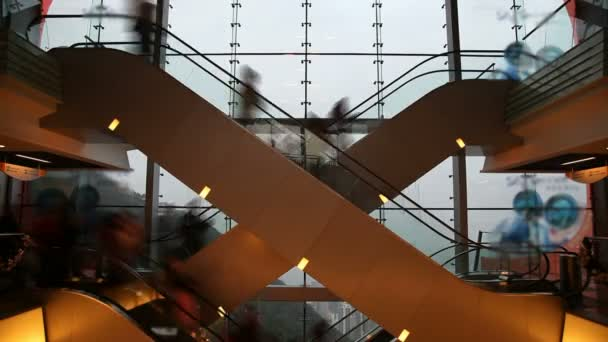 Timelapse video of people on escalators in a shopping mall