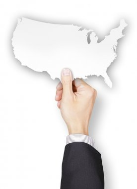 Hand of businessman holding USA shaped paper