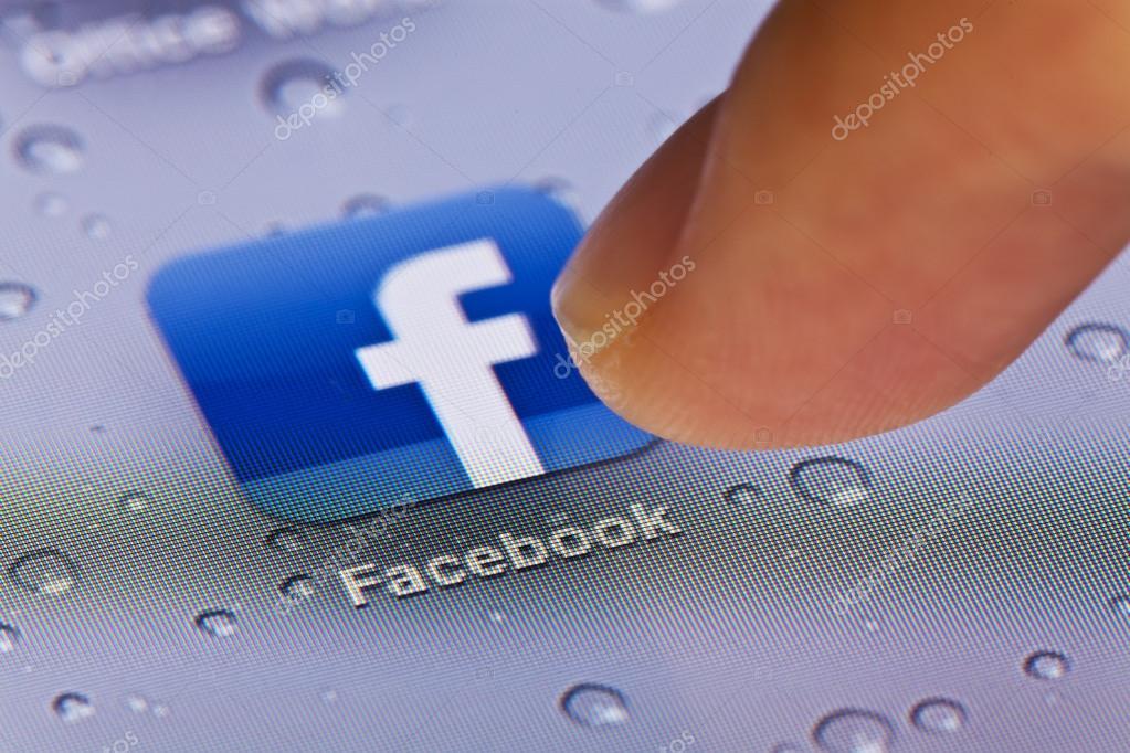 Macro image of running Facebook app on an iPad