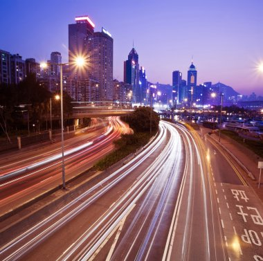 Hong Kong at night with traffic trails