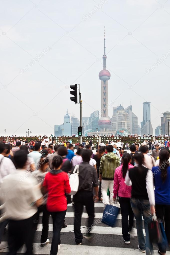 Commuters in a busy crosswalk at the Bund, Shanghai