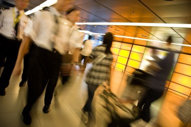 Customs officers and travellers in an airport