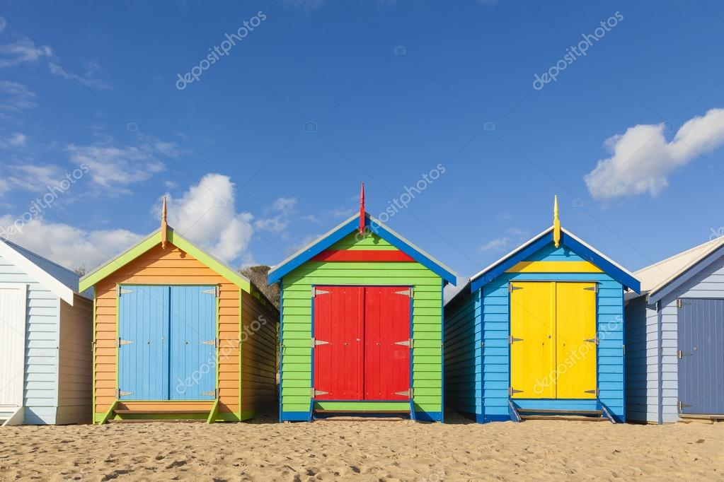 Bathing boxes in a beach with copyspace