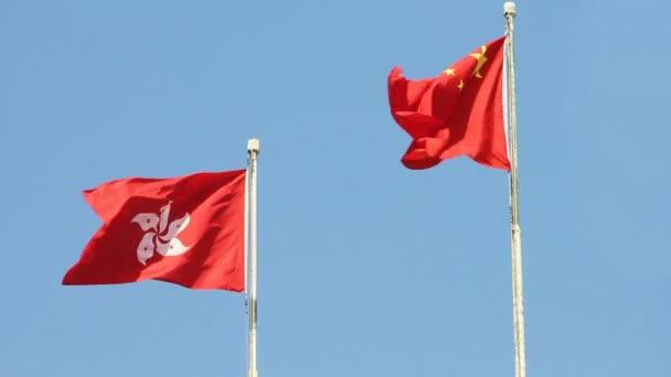 Flags of China and Hong Kong SAR waving in the wind