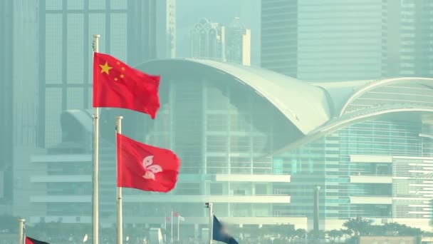 Flags of China and Hong Kong SAR waving in the wind