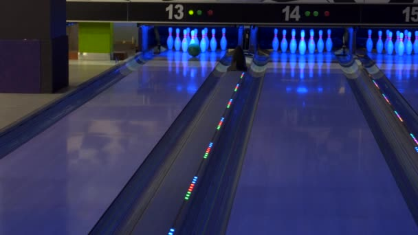 Colorful bowling alley. Bowling game. A bowling ball traveling down the lane and knocks down pins