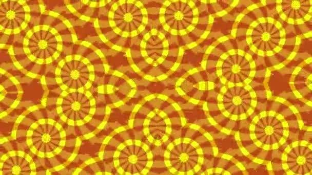 Pozadí s rotujícím kruhové červené žluté prvky, smyčka