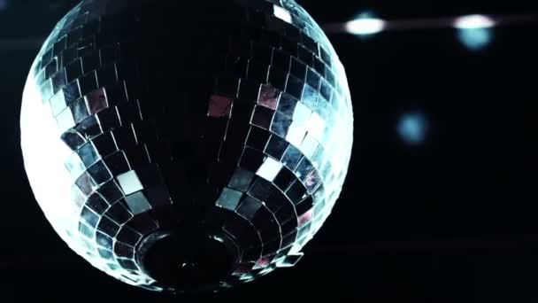 Disco mirrorball discoball spinning and reflecting light into a club venue
