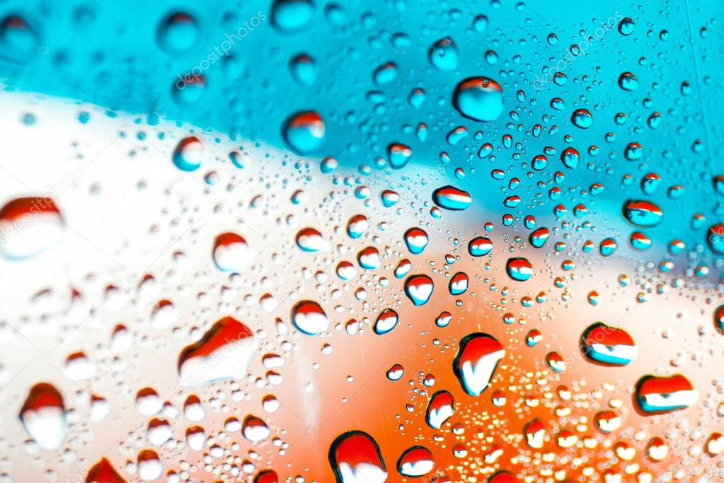 abstract orange background with water drops