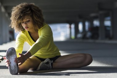 Girl stretching before workout