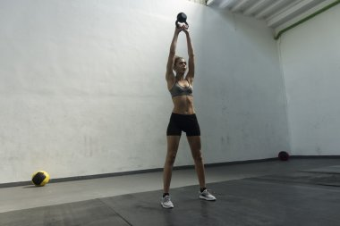Girl doing kettlebell swing