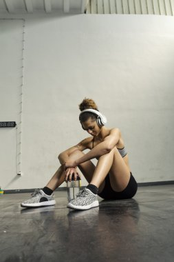 Girl resting after hard workout at the gym