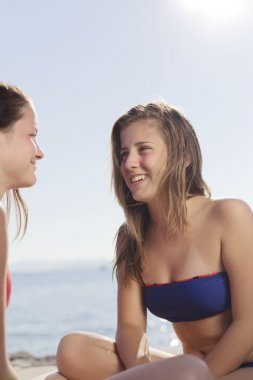 Two teenagers having fun on the beach
