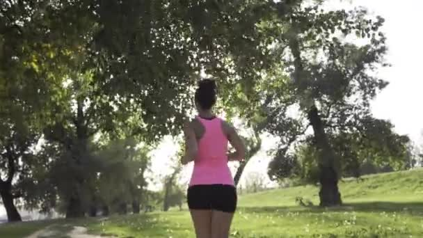 Attractive girl running in the park