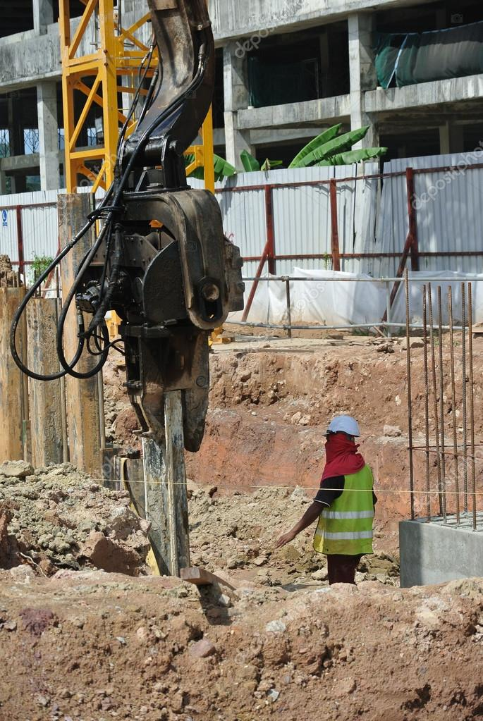 Retaining wall steel sheet pile installation by machine