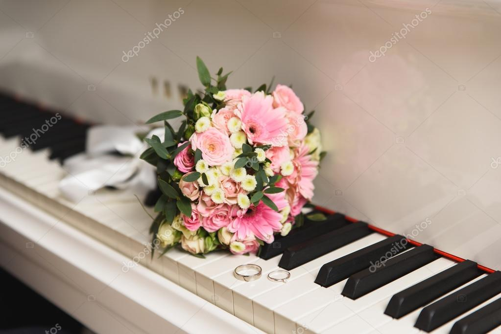 Wedding rings on the piano